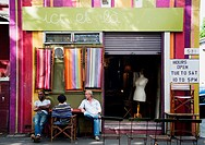 People having a chat out of a vintage shop, Surry Hills area, Sydney, Australia