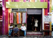 People having a chat out of a vintage shop, Surry Hills area, Sydney, Australia