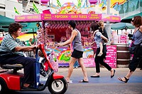 Visitors walking past the candies kiosk at the Easter Show, Sydney, Australia