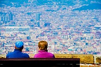 Contemplating Barcelona City from Montjuic Castle.Europe, Spain, Catalonia.March 2010.
