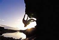 Man rock climbing bouldering The Overhang at Dierkes Lake Park in the Snake River Canyon near the city of Twin Falls Idaho USA