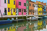 coloured houses and boats on canal,  the island of Burano Venice Italy