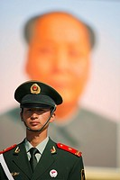 Soldier in front of the huge portrait of Chairman Mao in Tianenmen Square, Beijing