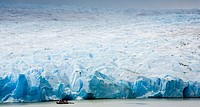 Chile, Southern Patagonia, Torres Del Paine National Park  Tourist boat on the Lago Grey dwarfed by the sheer ice wall of the Grey Glacier and the Pat...