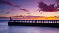 England, North Yorkshire, Whitby  One of the entrance piers of Whitby Harbour at dawn