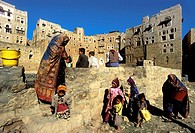 Asia,Yemen,Hababa village built around a water cistern where medieval houses reflect