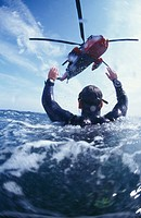 Search and REscue helicopter from Royal Navy Culdrose, Cornwall, England search and rescue diver performing rescue