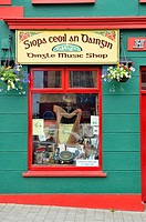 The Irish harp pride of place in the window of the Dingle Music Shop  Dingle town on the Dingle Peninsula, County Kerry, Ireland