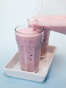 Mixed Berry Smoothie isolated against a blue background