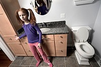 Preteen redhead girl in her bathroom