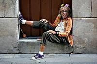 Old woman in doorway smoking a cigar, Havana, Cuba