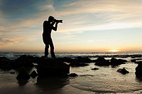 Silhouette of photographer on the beach