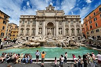 Spectacular view of the Trevi Fountain full of tourists, Rome