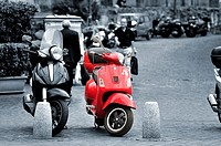 Image in B&N with two bikes a red Vespa