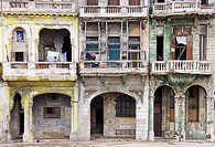 Cuba - Many buildings and their façades at the Malecón, the famous oceanfront promenade of Cuba´s capital Havana, are in quite a bad state