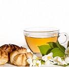 cup of herbal jasmine tea with éclair