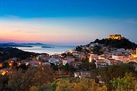 Begur village and castle at dusk with Medes Islands L´Estartit at the background Costa Brava Baix Empordà Catalunya Spain