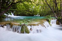 The Plitvice Lakes in the National Park Plitvicka Jezera in Croatia  The lower lakes, the waterfalls of the V  Cascade  The Plitvice Lakes are a strin...