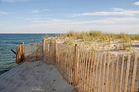 A new fence supports an ancient set of dunes, Long Beach Island, New Jersey, USA.