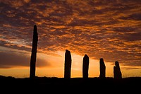 RING OF BRODGAR ORKNEY Neolithic standing stones orange and grey sunset cloudy dusk sky