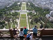 Tourist on the Eiffel Tower looking over Champs de Mars, Paris, France