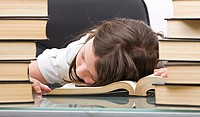 Shot of a Young School Child Asleep at her Desk