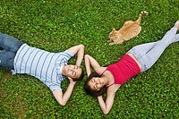 teenagers listening to music and relaxing with pet cat