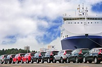 Vehicles from the Volvo Cars assembly plant waiting to loaded on the roll_on/roll_off / roro ship at the Ghent seaport, Belgium