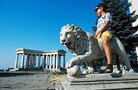 Little boy sitting on lion statue, Odessa, Ukraine