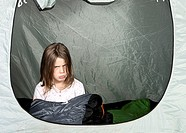 Shot of a Young Girl looking Unhappy in her Tent