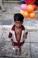 Little boy selling balloons, Janmashtami Festival, New Delhi, India