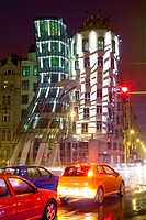 prague, czech republic - the dancing house and traffic in rain