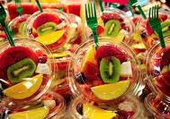 Fruit salads in La Boqueria market, Barcelona. Catalonia, Spain