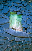 A slate roof with shuttered window, in the Sierra de Ancares near Penoselo, north of Villafranca del Bierzo, Leon province, Northern Spain