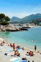People bathing in Cote de Azur public beach  Riviera seashore in Nice, France