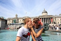 Romantic couple at Trafalgar Square, London