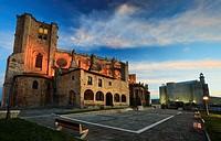 Santa María de la Asuncion Church and lighthouse at dawn. Castro Urdiales, Cantabria, Spain.