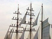 Sailors atop Mast on Tall Ship. Concept might read Hang on...help is coming.