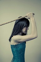 Young woman pulling on the end of a rope