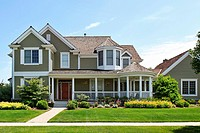 Suburban home with green siding and front porch