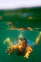 A man swimming underwater in the Mediterranean sea Italy