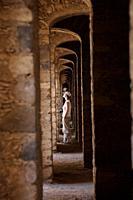 A tourist walks inside the multiple arches inside the Santa Brigida, an abandoned gold mine, in Mineral de Pozos, San Luis de la Paz, Mexico  Mineral ...