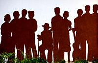 A mural of silhouettes representing victims of the Spanish Civil War covers a wall in Benamahoma village, Cadiz province, Andalusia, Spain.