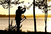 Disable man is taking a photograph of the sunset at the Columbia river, Oregon, USA.