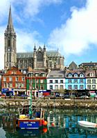 The harbor and St Colemans Cathedral of the costal town of Cobh in Ireland