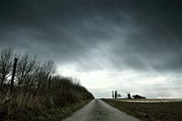 Landscape with an old windmill during winter. Dramatic sky. Shot in North Rhine-Westphalia, Germany.