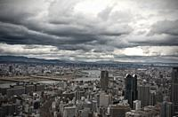 Stormy clouds over the city of Osaka, Japan. Bridges are crossing river yodo.