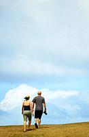Couple walking to top of hill