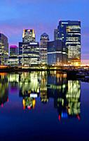 Canary Wharf viewed at night from Blackwall Basin, London, England