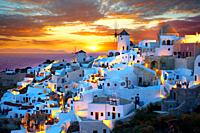Oia  Ia  Santorini - Windmills and town at sunset, Greek Cyclades islands - Photos, pictures and images